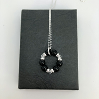 Onyx and Swarovski Crystal Circle of life pendant. Sterling Silver