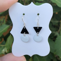 Topsy-turvy Hand enamel earrings. Black and white enamel earrings.