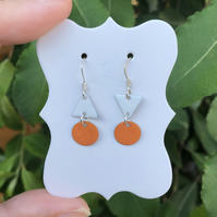Topsy-turvy Hand enamel earrings. Orange and white enamel earrings.