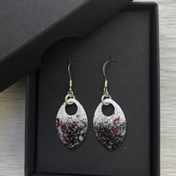 Black & white with a touch of red enamel scale earrings. Sterling silver.