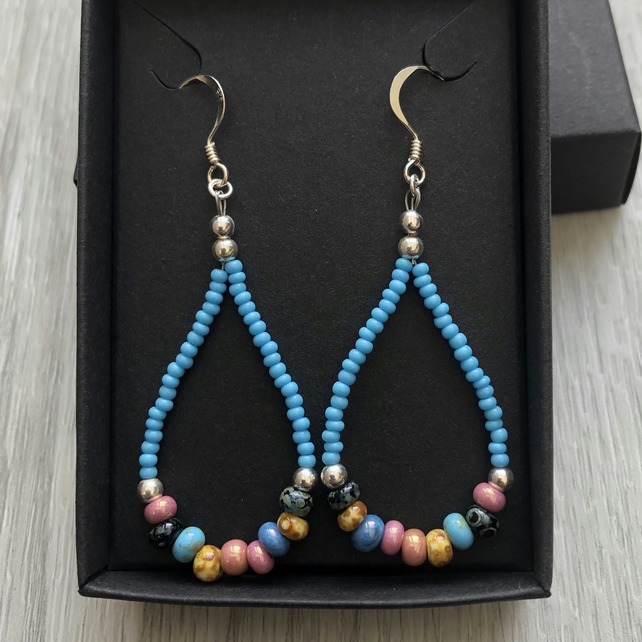 Blue beaded drop earrings. Sterling silver.