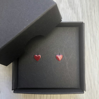 Dark red enamel heart studs. Sterling silver studs.