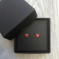 Bright red enamel heart studs. Sterling silver studs.