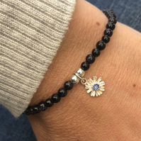 Blue Goldstone beaded bracelet with flower charm