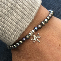 Freshwater pearl stretch bracelet with dragonfly charm