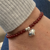 Red carnelian bracelet with puffed heart charm