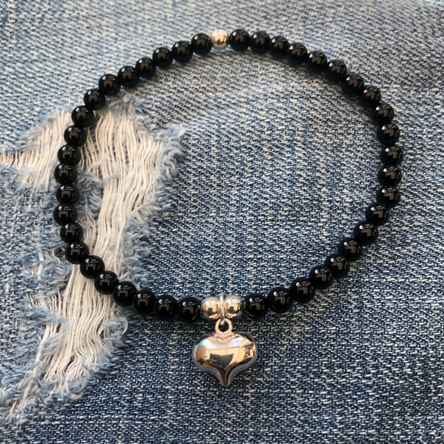 Black onyx bracelet with puffed heart charm