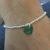 Green enamel heart on silver beaded stretch bracelet. Stacking bracelet.