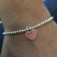 Pale pink enamel heart on silver beaded stretch bracelet. Stacking bracelet.