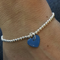 Mid blue enamel heart on silver beaded stretch bracelet. Stacking bracelet.