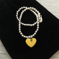 Yellow enamel heart on silver beaded stretch bracelet. Stacking bracelet.