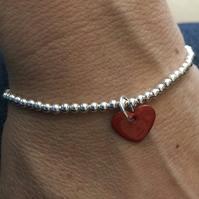 Red enamel heart on silver beaded stretch bracelet. Stacking bracelet.
