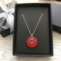 Red enamel disc and sterling silver heart. Sterling silver necklace.