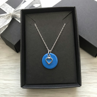 Blue enamel disc and sterling silver heart. Sterling silver necklace.