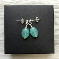 Green glass drop post earrings. Sterling silver