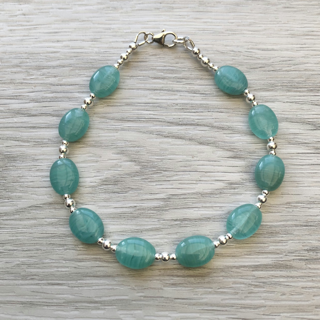 Green blue Czech glass and sterling silver bracelet.