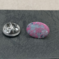 Hand enamelled lapel pin. Pink, turquoise & silver leaf.