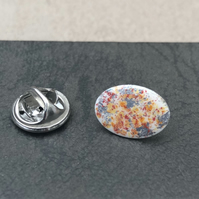 Hand enamelled lapel pin. White, red, orange & silver leaf.