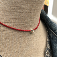 Red seed bead choker with sterling silver heart.