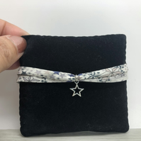 SALE..Ribbon bracelet, sterling silver star charm. Liberty of London ribbon.
