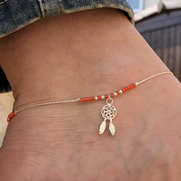 Dream catcher & orange seed bead floating anklet. Sterling silver.