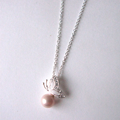 Butterfly and pearl pendant