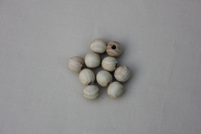 Turned wooden ash beads
