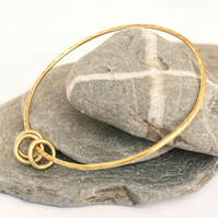 Brass bangle with hoops