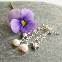 Long pearl and silver star earrings