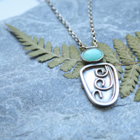Silver botanical necklace with apatite gemstone
