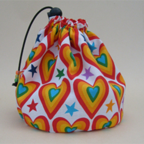 Hand made sock knitting / small project drawstring cosmetics bag. Alexander Henry 'Rainbows'