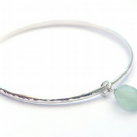Sterling silver hammered bangle with blue chalcedony gemstone