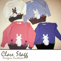 Child's jumper with rabbit and bobble tail