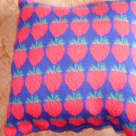 Navy cushion with a strawberry design. 100% machine washable cotton. 18""