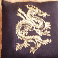 Black cushion with a metallic gold chinese dragon design. Cotton. 18""