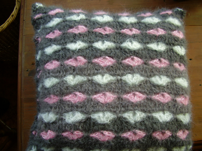 Grey mohair crochet cushion with pink and white hearts. 18""