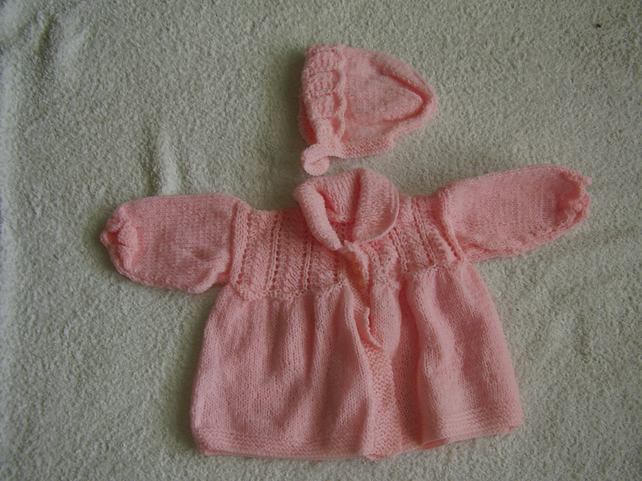 Hand knitted pink baby cardigan and hat