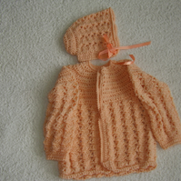 Crochet baby cardigan and hat in apricot wool