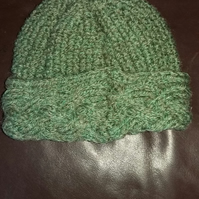 Green handknitted Aran baby hat