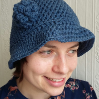 Crochet chunky hat in blue wool & acrylic with flower trim