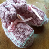 Pink bootees, hand knitted
