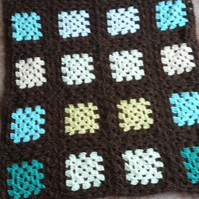 Brown crochet granny squares blanket