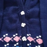 Cardigan or jumper with fish round the bottom