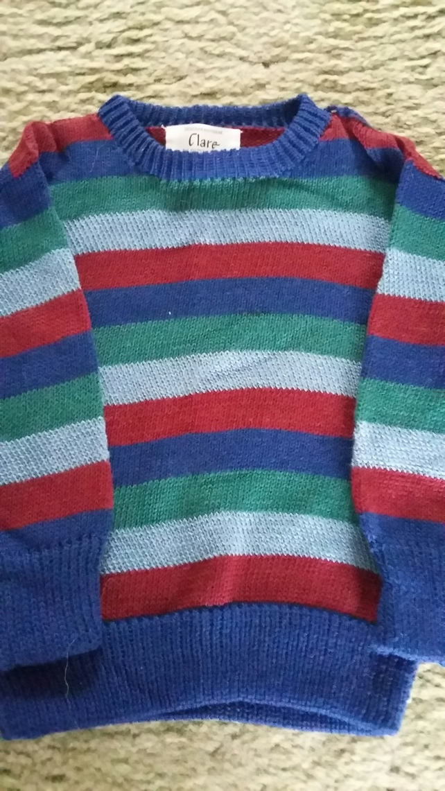 Striped cotton jumper in navy, maroon and green. 7-8 yrs