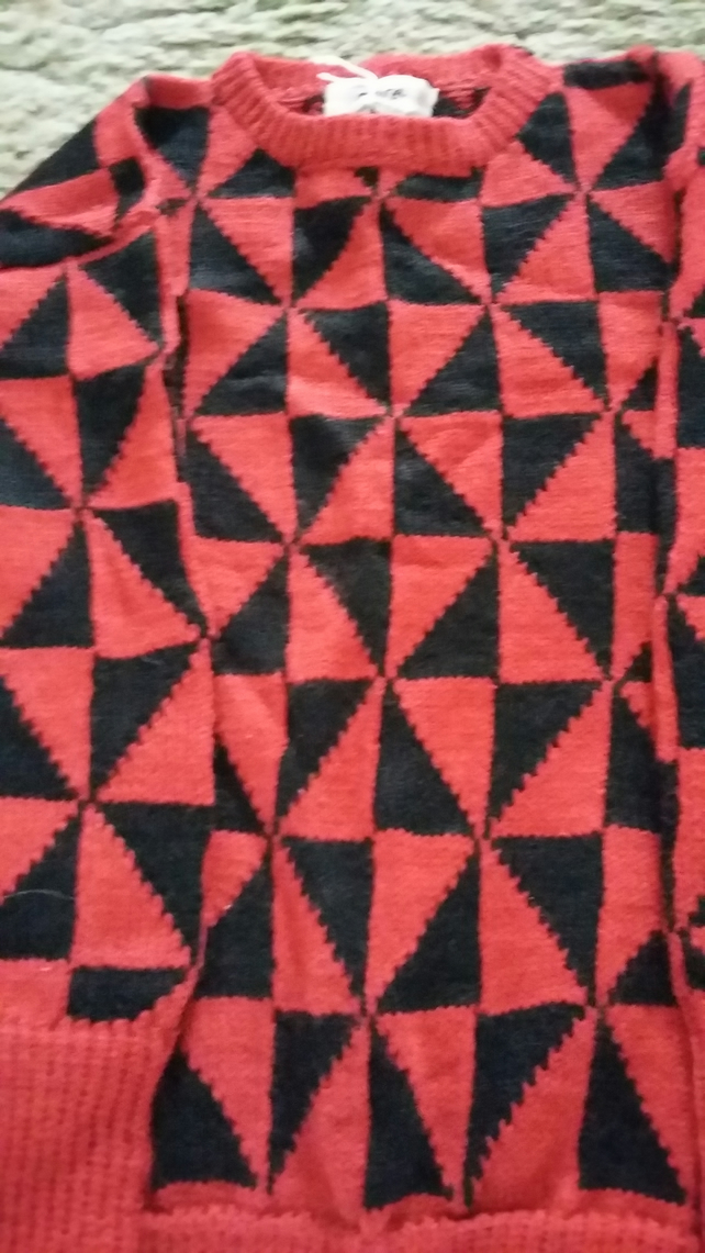 Black and rust geometric jumper size 7-8 years.