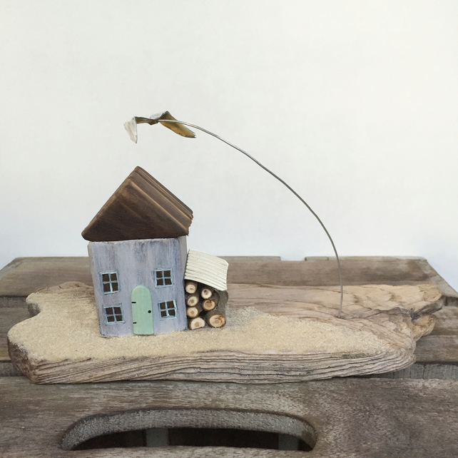 Handmade cottage on driftwood