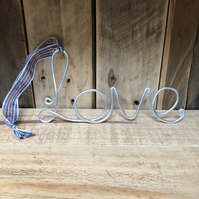 Wire word 'Love' with tartan ribbon