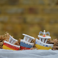 Red, white and blue ceramic boat