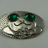 Pewter frog Brooch with green cabochon eyes