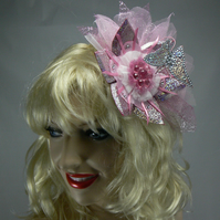 Pink sparkly fascinator with hovering butterfly
